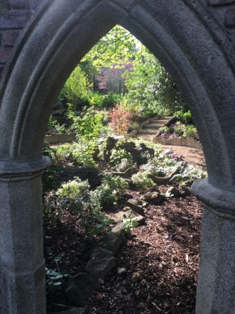 Garden viewed through stone archway