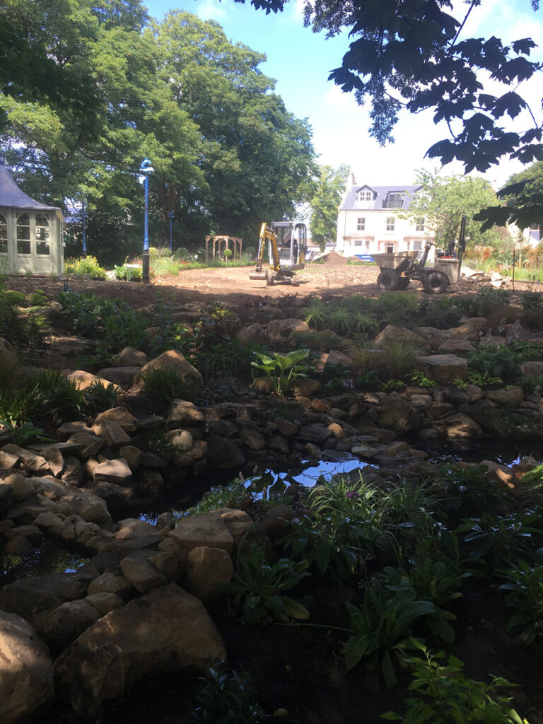 Construction of a water feature and lawn