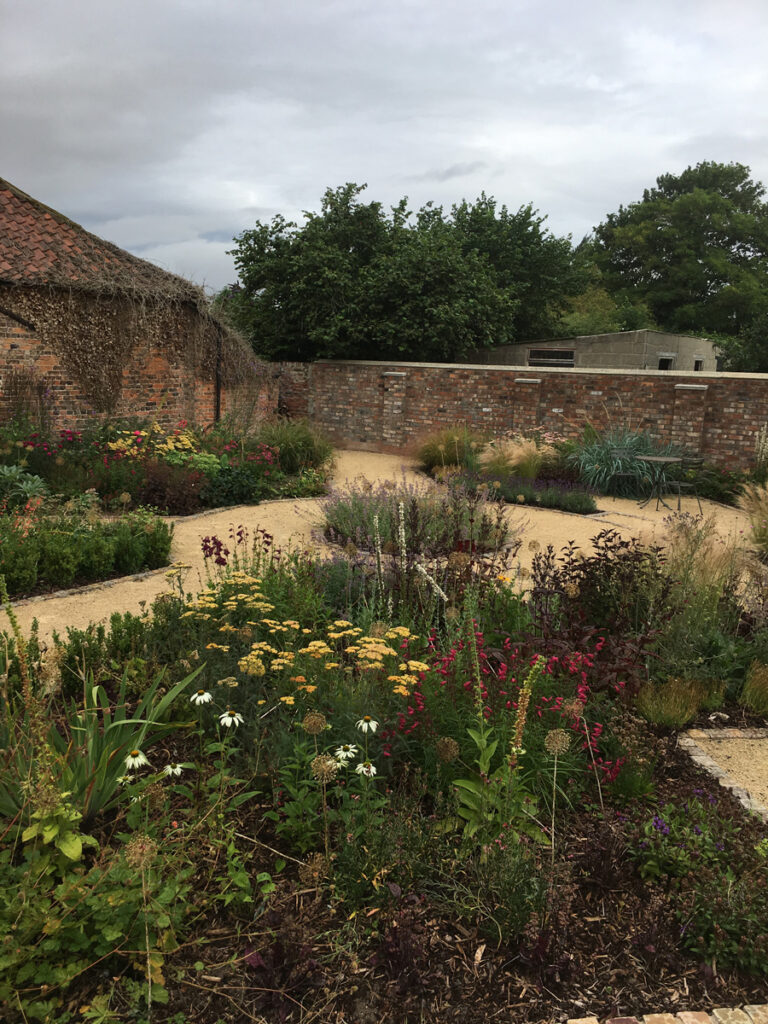 Completed round feature path with planted beds