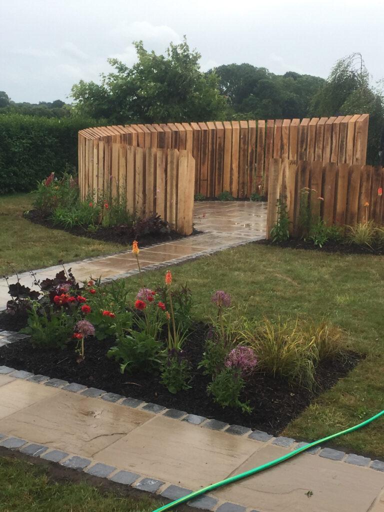 Sweeping circular wooden garden feature